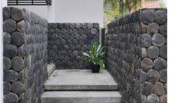 desain tembok dengan batu alam